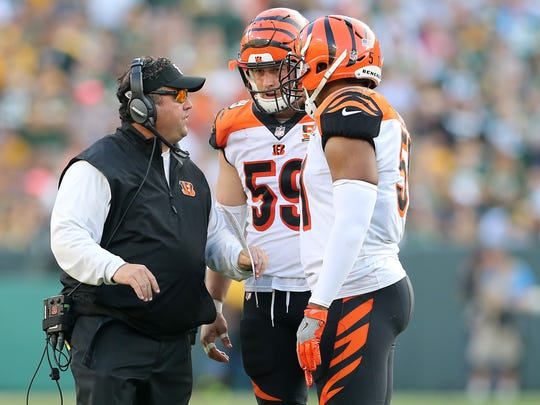 Cincinnati Bengals defensive coordinator Paul Guenther talks to outside linebacker Nick Vigil (59) and outside linebacker Vincent Rey (57) in the fourth quarter during the Week 3 NFL football game between the Cincinnati Bengals and the Green Bay Packers, Sunday, Sept. 24, 2017, at Lambeau Field in Green Bay, Wisconsin.