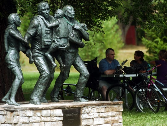 """Human Spirit"" sits in Creekside Park as a reminder"