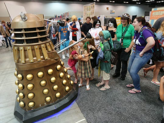A Dalek robot from Dr. Who entertains the crowd as it verbally interacts with fans during the opening day of Indy PopCon at the Indiana Convention Center in downtown Indianapolis on Friday, June 26, 2015. The event runs through Sunday, June 28.