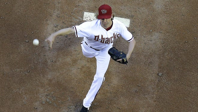 Diamondbacks pitcher Bronson Arroyo throws against the Cincinnati Reds during the first inning of a baseball game, Friday, May 30, 2014 in Phoenix.