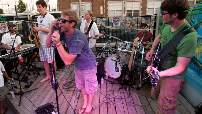 Shaker and the Egg was a mainstay of the Sardine Can tiki bar during the Farmers Market on Broadway in the early 2010s. The band is reuniting to play a block party outside the bar on Wednesday night.