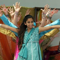 Niki Singh, 12, front, performs a Bhangra, a folk dance from Northern India. This year's festival is Saturday at JetBlue Park in Fort Myers.