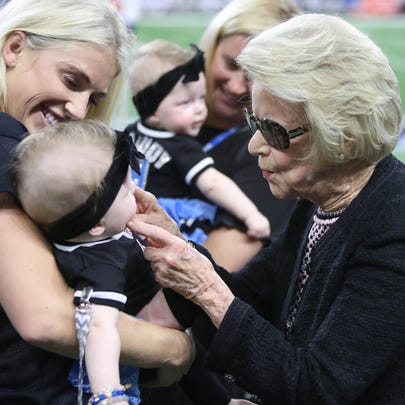 Lions owner Martha Ford plays with Sawyer Stafford