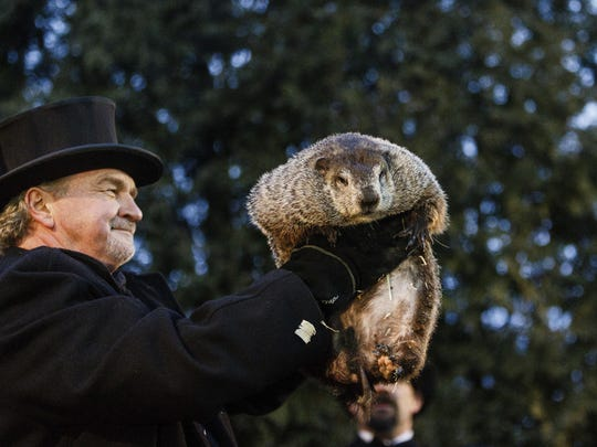 The Associated PressGroundhog Club handler John Griffiths holds Punxsutawney Phil, the weather prognosticating groundhog, during the 131st celebration of Groundhog Day on Gobbler's Knob on Thursday in Punxsutawney, Pennsylvania. Phil's handlers said that the groundhog has forecast six more weeks of winter weather. Groundhog Club handler John Griffiths holds Punxsutawney Phil, the weather prognosticating groundhog, during the 131st celebration of Groundhog Day on Gobbler's Knob in Punxsutawney, Pa. Thursday, Feb. 2, 2017. Phil's handlers said that the groundhog has forecast six more weeks of winter weather. (James Robinson/PennLive.com via AP)