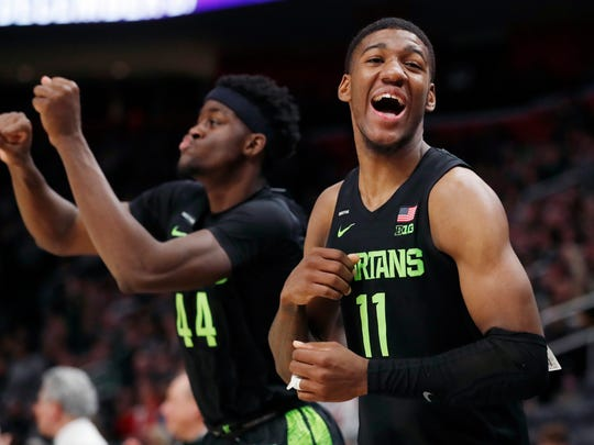 Michigan State forward Aaron Henry (11) and forward Gabe Brown (44) celebrate at the end of the second half of an NCAA college basketball game against Oakland, Saturday, Dec. 14, 2019, in Detroit. (AP Photo/Carlos Osorio)