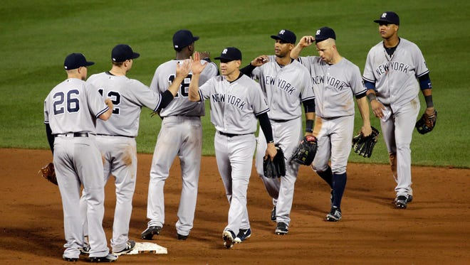 Members of the New York Yankees celebrate after closing out a baseball game against the Baltimore Orioles in Baltimore, Saturday, June 4, 2016. New York won 8-6.
