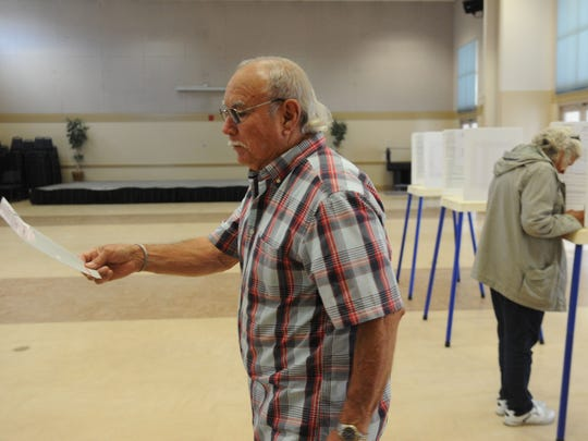 Jim Nunez votes at the South Oxnard Community Center on Tuesday in the Oxnard recall special election. The mayor and three council members survived an attempt to recall them.