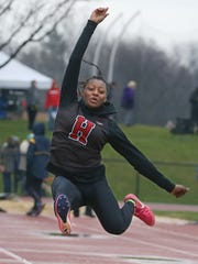 Anaya Dees, Hilton, stretches out on her second jump in the girls long jump.