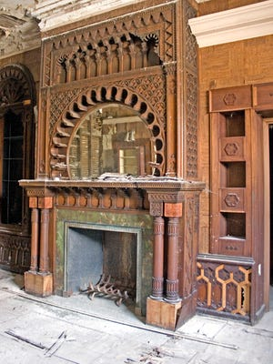 This fireplace in the front room of 359 W. Church St. in Elmira may be the most magnificent of several throughout the historic building.