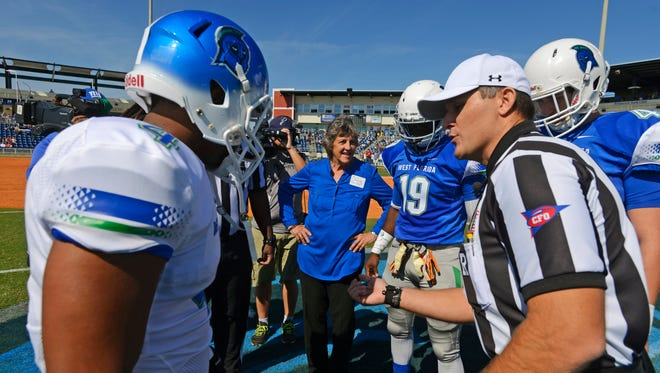 University of West Florida President Dr.  Judy Bense checks out the coin toss Saturday during the UWF football team's scrimmage at Blue Wahoos Stadium.