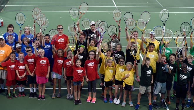 Members of the Henderson Tennis Club's elementary league pose for a photo at the Doc Hosbach Tennis Complex in Henderson Tuesday.  More than 60 students are participating in the six-week program for kids ranging from age 7 to 11.