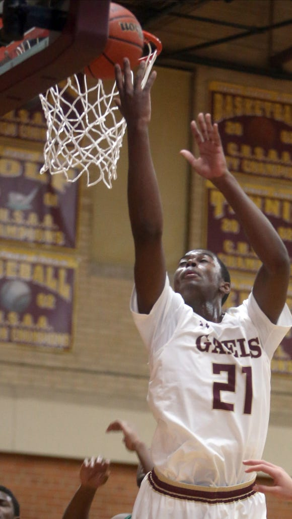 Iona Prep's Josh Alexander shoots during a varsity basketball game against Holy Cross at Iona Prep in New Rochelle Dec. 15, 2016. Iona Prep defeated Holy Cross 67-57.