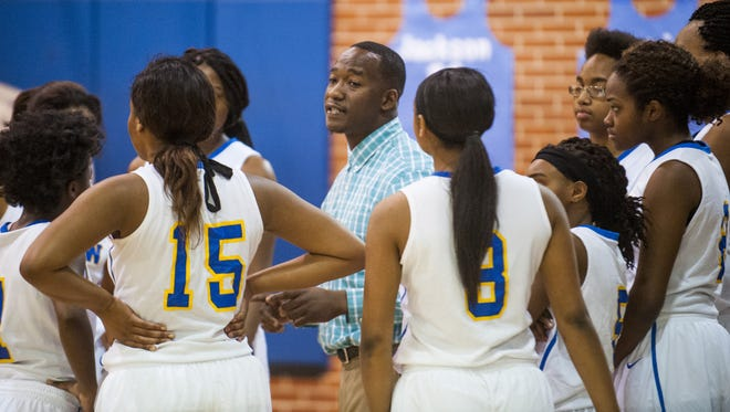 BTW Magnet coach Teklia Roberson coaches against Elmore County in area tournament action at Lanier High School in Montgomery, Ala. on Saturday February 12, 2016.