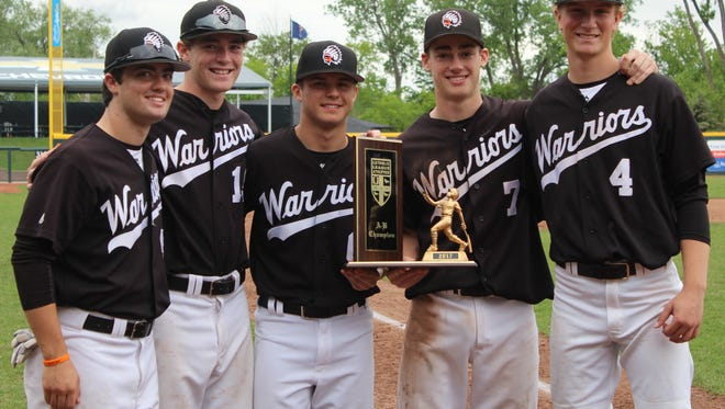 Brother Rice seniors (left to right) Kyle Livingway, Christian Faust, Nate Feldman, Kevin Tyranski and Alex Kuster proudly pose with the Catholic League championship trophy.