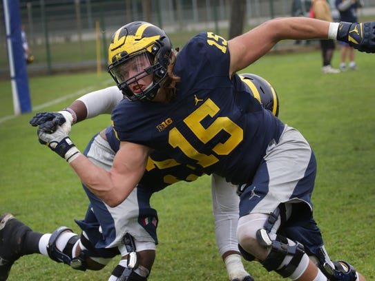 U-M's Chase Winovich takes part in a drill during the