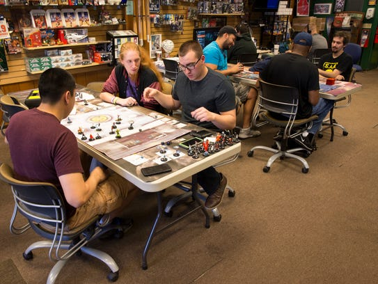 Friday mid-afternoon gamers play board games at The