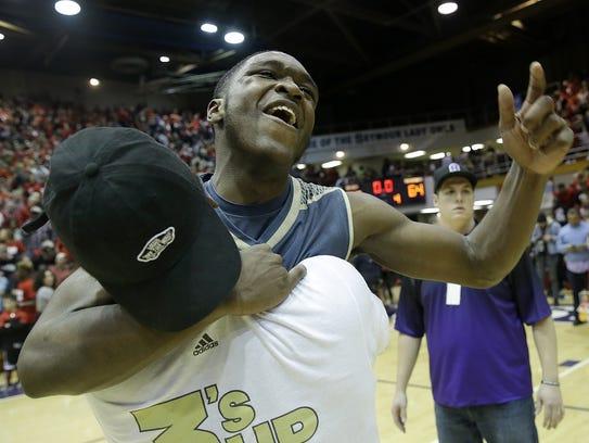 Warren Central's Dean Tate celebrates the Warriors'