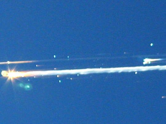Debris from the space shuttle Columbia streaks across