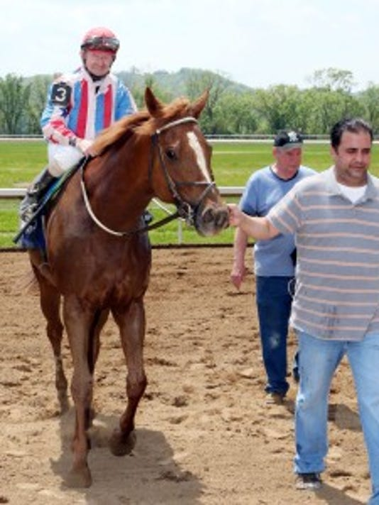 Perry Ouzts won Belterra's first race for his longtime clients trainer Joe Woodard and Billy, Donna and Justin Hays of Louisville.