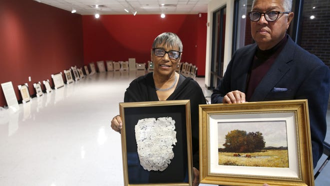 "Bernard and Shirley Kinsey, founders of ""The Kinsey Collection""  hold two of the over 100 pieces of African-American history, artifacts, documents, and artwork dating as far back as 1595 that will be on display at FAMU starting Saturday."