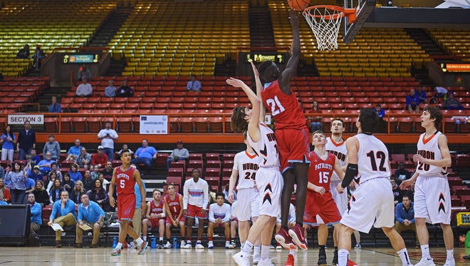 Empty seats were a common sight at the Class AA state basketball tournament in Rapid City.
