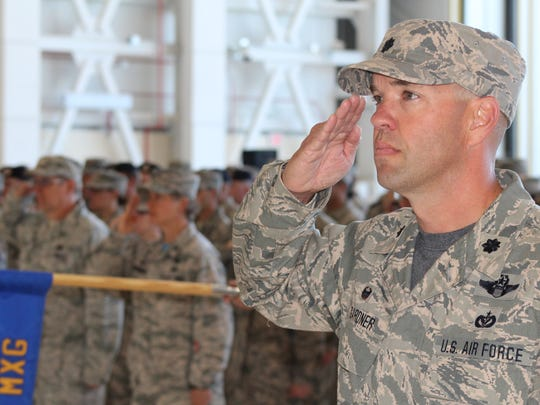 Montana Air National Guard airmen stand at attention during a change of command ceremony.
