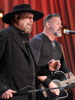 Eddie Montgomery and Troy Gentry of Montgomery Gentry perform at the telethon for 'Dolly Parton's Smoky Mountains Rise: A Benefit for the My People Fund' in December 2016.