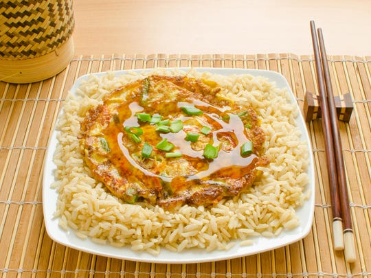 Egg foo yung pancakes are made with chopped stir-fry ingredients; serve over steamed rice.