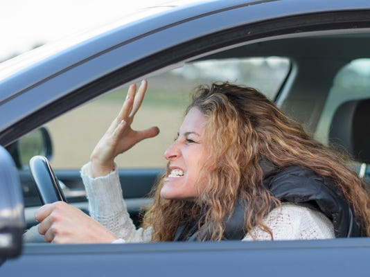 woman is driving her car