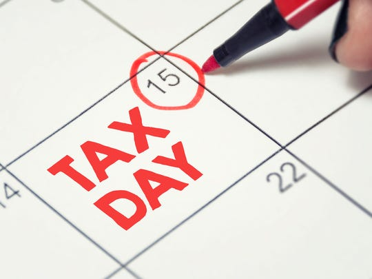 April 15 date circled in red on calendar, with the words TAX DAY written in red letters on that calendar square.