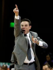 Louisville head coach Rick Pitino reacts to a foul call during the first half of an NCAA college basketball game against Grand Canyon, Saturday, Dec. 3, 2016, in Phoenix.