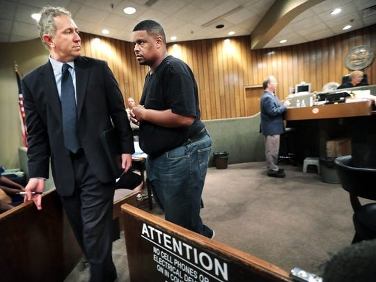 Rick Trotter appears in general sessions court with his attorney Marty McAfee (left) for a hearing on charges that he photographed individuals without their consent. (Jim Weber/The Commercial Appeal)