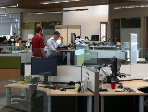 Employees work at the new Workiva headquarters building in Ames.