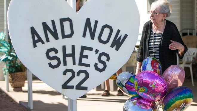 Elizabeth Prescott walks out to the sign in front of her home the day before her birthday in Apache Junction, Ariz. on Sunday, February 28, 2016. Prescott was born on a leap-year on February 29, 1928.