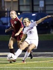 Elmira's Ciera Sprague kicks the ball ahead in front
