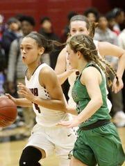 Elmira's Kiara Fisher drives toward the basket as Seton