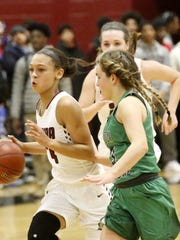 Elmira's Kiara Fisher drives toward the basket as Seton Catholic Central's Hanna Strawn defends last year during a girls basketball semifinal at the Josh Palmer Fund Elmira Holiday Inn Classic at Elmira High School.