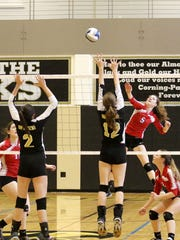 Brinn Shaughnessy of Owego goes up for a spike in front