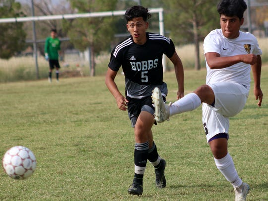 Alamogordo's Jr. Barbosa fires a shot at the goal.