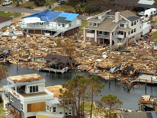 Hurricane Ivan's storm surge brought up to six feet of debris into the backyards of some of the homes in the Grande Lagoon neighborhood.