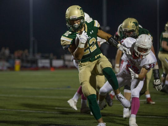 Red Bank Catholic's Zack Bair runs the ball into end zone against Wall. The Caseys won the B North title last season.