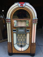 A recently bought jukebox that Mickey Treat is working to restore.