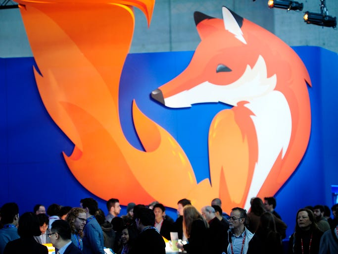 People gather in the Firefox booth at the 2014 Mobile World Congress on Feb. 27 in Barcelona.