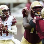 De'Andre Johnson drops back to pass during Florida State's Garnet and Gold spring game at Doak Campbell Stadium.