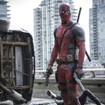 "This image released by Twentieth Century Fox shows Ryan Reyonlds in a scene from ""Deadpool."""