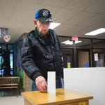 Jean Curry casts her ballot in the Binghamton school budget election Tuesday at Theodore Roosevelt Elementary School.