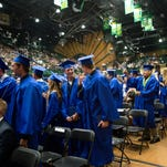 The Poudre High School class of 2014 celebrates graduation in this file photo. Poudre students Aya Ahmad and Cody Armstrong were named Daniels Scholars Friday.