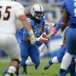 UK LB Josh Forrest intercepts the pass and returns it for a touchdown during the first half of the University of Kentucky Wildcats Football game against Louisiana-Monroe in Lexington, KY. Saturday, October 11, 2014.