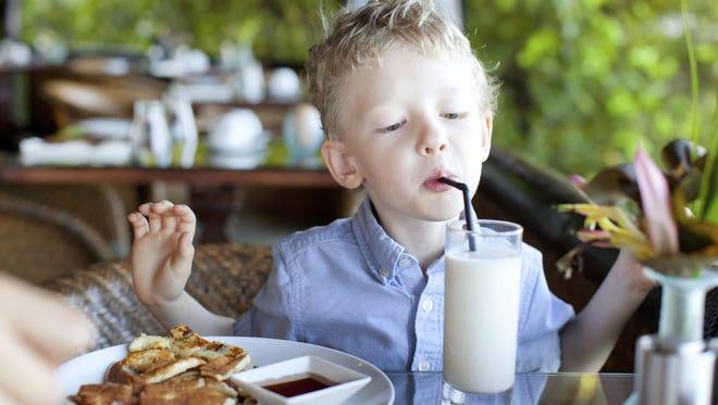 Kid enjoying his meal.
