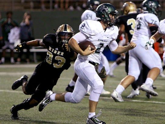 Kennedale quarterback Evan Jowers (2) slips past Rider's